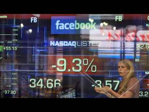 Facebook shares plunge to record low
